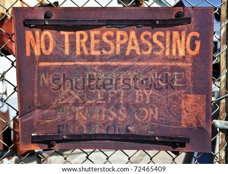 Old, Rusty No Trespassing Sign - stock photo