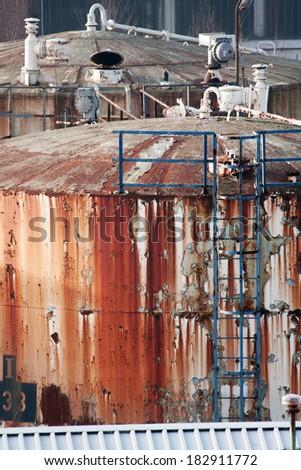 Old Rusty Oil Tanks in Bad Shape - stock photo