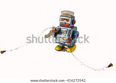 old rusty on robot toy - stock photo