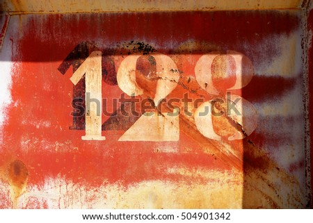 old rusty painted metal wall with numbers, wallpaper background