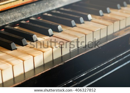 Old rusty piano keyboard, selective focus, soft light filter - stock photo