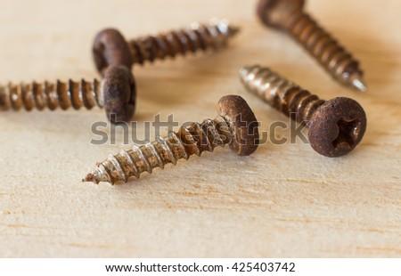 Old rusty screws - stock photo