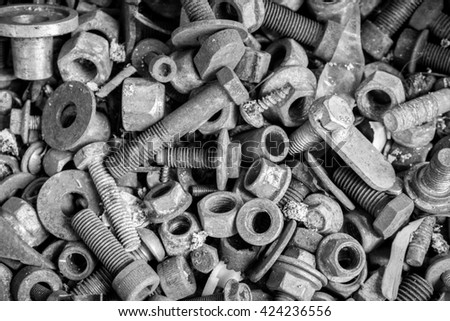 old rusty screws, nuts and bolts with dust grunge monotone style - stock photo