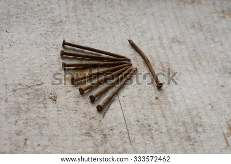 Old rusty tack on the paper. - stock photo