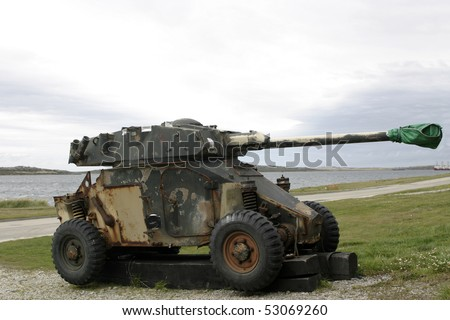 old, rusty tank remained from Falkland war beside the road in Port Stanley, Falklands - stock photo