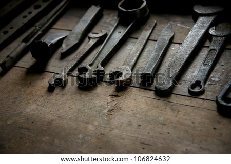 Old rusty tools on a table - stock photo