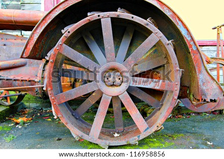 Old rusty vintage farm tractor - stock photo