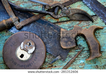 Old Rusty Vivid Tools on Work Bench - stock photo