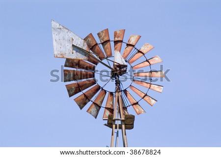 Old rusty wind-pump - stock photo