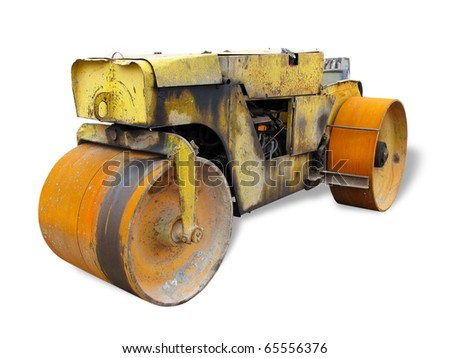 Old rusty yellow road roller isolated over white background - stock photo