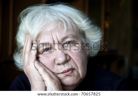 Old sad woman - stock photo