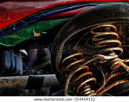 old saddle spring in high dynamic range image - stock photo