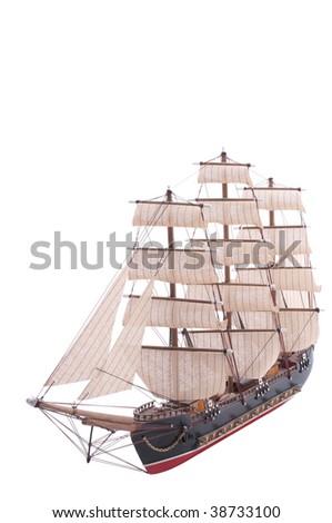 old sailboat model isolated on white - stock photo