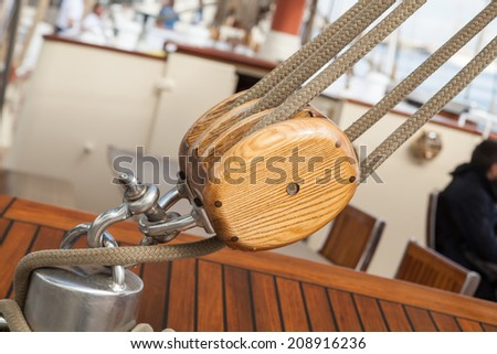 old sailing boat detail. pulleys and ropes - stock photo