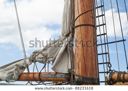 Old sailing ship masts and sails and rigging - stock photo
