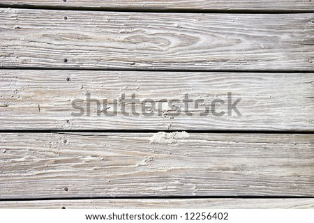 Old sandy worn planks on a beach boardwalk. Good for background or texture - stock photo