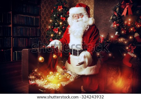 Old Santa Claus with Christmas gifts at home. Christmas decoration.  - stock photo