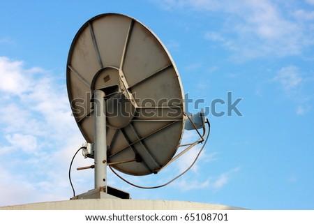 Old satellite dish on sky - stock photo