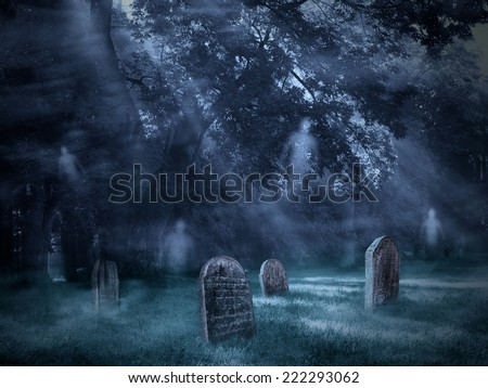 Old Scary Graveyard with flying ghosts - stock photo