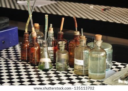 old school chemistry laboratory glass recipe - stock photo