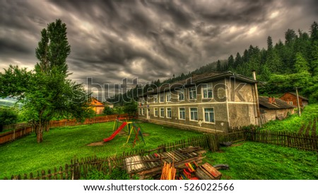 old school in storm clouds, Romania