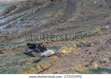 Old school shose on Mud, nobody  - stock photo