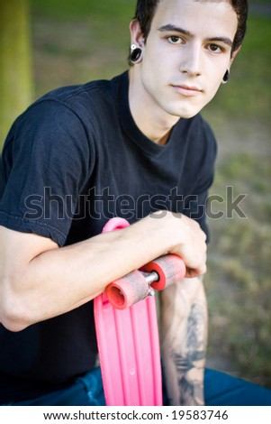 old school skater holding this board - stock photo