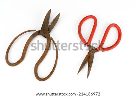 old scissors full of rust isolated on white background - stock photo