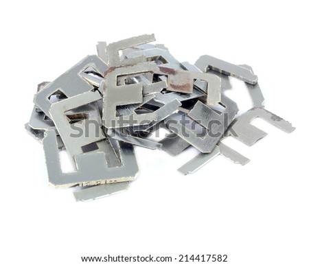 Old scrapheap of silicon steel on white background (steel for transformer)