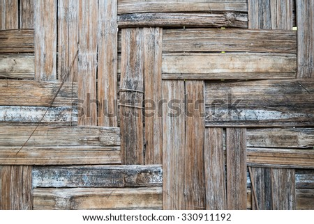 Old scratched bamboo wood cutting board background detail