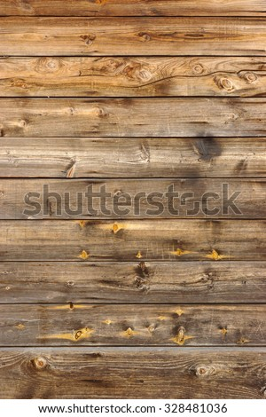 Old Scratched Brown Empty Wood Panel Vertical Texture Background Close-up - stock photo