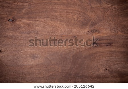 Old scratched wooden board - stock photo