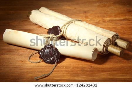 Old scrolls, on wooden background - stock photo
