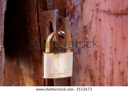 Old Security rusty padlock background - stock photo