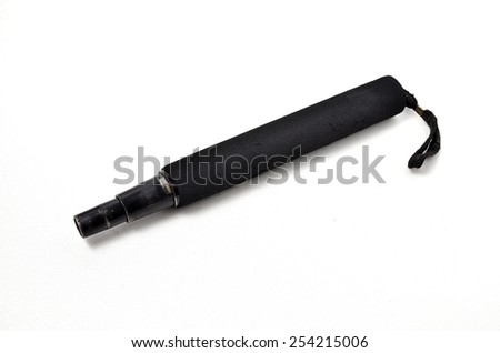 Old Self Defend Equipment. Shoot over white background. Focus on the important part. Shallow depth of field. - stock photo