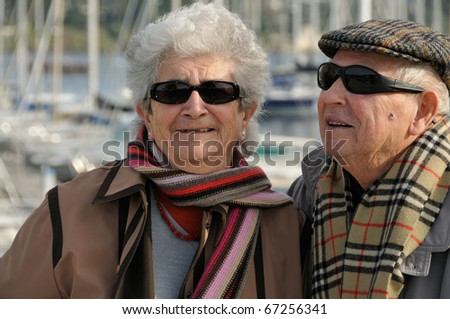 Old senior couple laughing and having fun - stock photo
