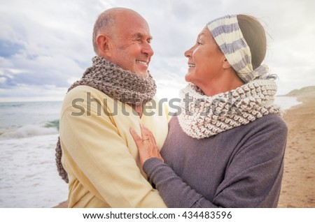 old senior couple outdoors on the coast - stock photo