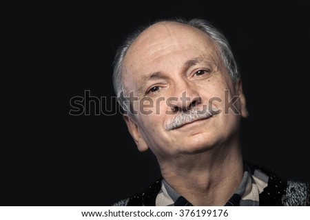 Old senior man closeup serious expression portrait - stock photo
