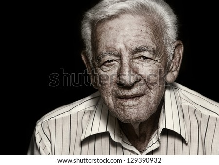 Old senior man serious expression dark sepia effect - stock photo