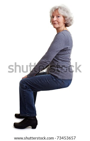 Old senior woman sitting on an imaginary chair or stool - stock photo