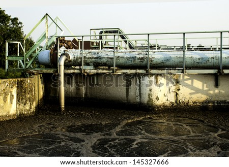 Old sewage treatment plant with a dirt - stock photo