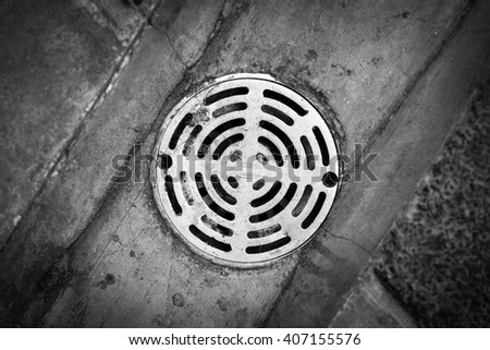 Old sewer grate drain water - Black and White - stock photo