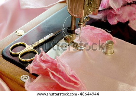 old sewing machine and sewing accesories - stock photo