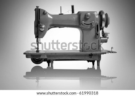 Old sewing machine isolated in a light background - stock photo