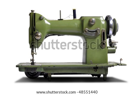 Old sewing machine isolated in white - stock photo