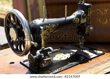 old sewing machine on a table - stock photo