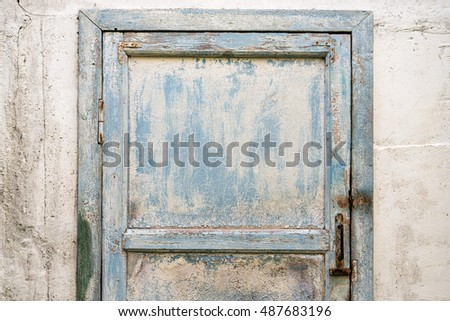 Old shabby blue door