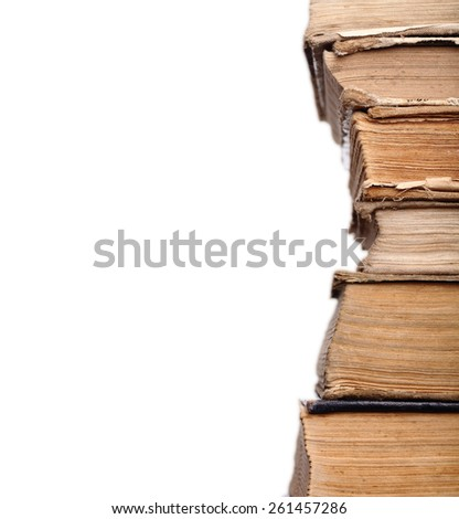 Old shabby books in the stack - stock photo