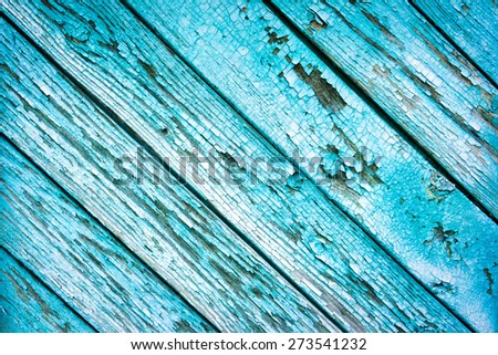 Old Shabby Wooden Planks with cracked blue color Paint, background