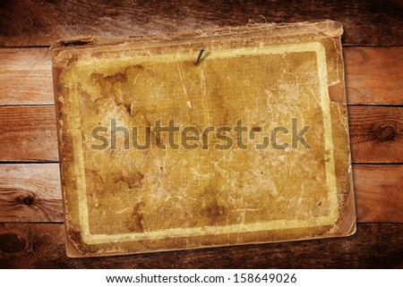 Old sheets of paper on a wooden background